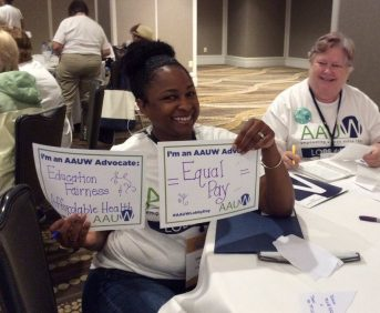 AAUW Greensboro members with advocate signs