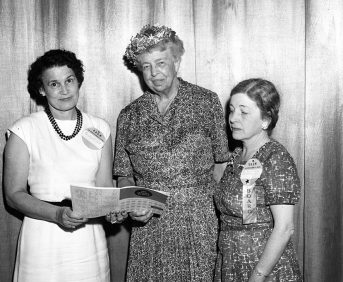 Black and white photo of Eleanor Roosevelt at the AAUW National Convention in June 1959 with two AAUW members.