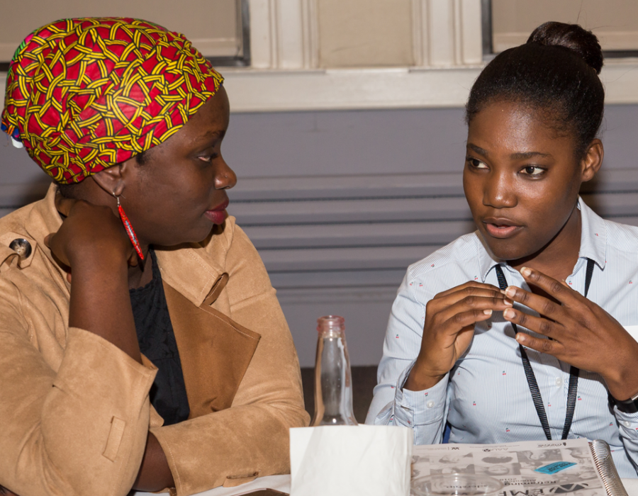 Three young women empower participants chatting during a break in the workshop