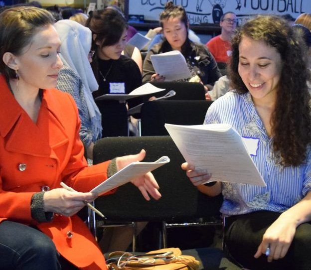 Women attendees at an in-person Work Smart workshop in Washington, D.C. participate in a salary negotiation role-playing exercise.