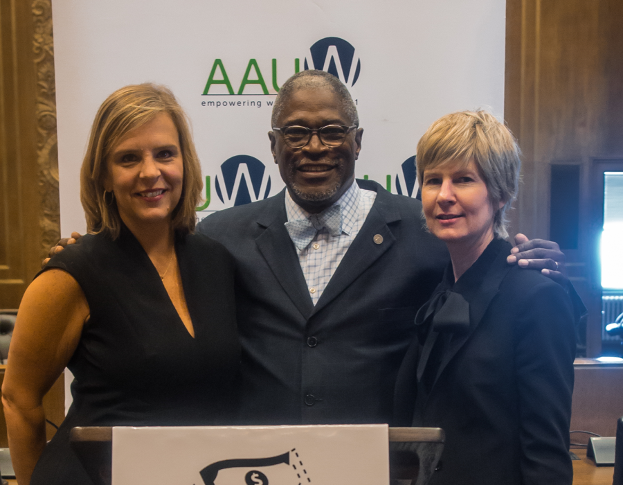 AAUW CEO Kim Churches, Kansas City Mayor James SLY, and Wendy Doyle posing in front of an AAUW Banner