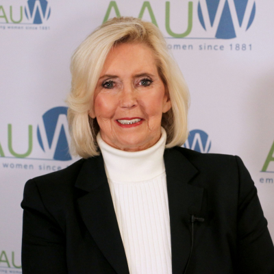 Photo of Lily Ledbetter in front of AAUW logo backdrop