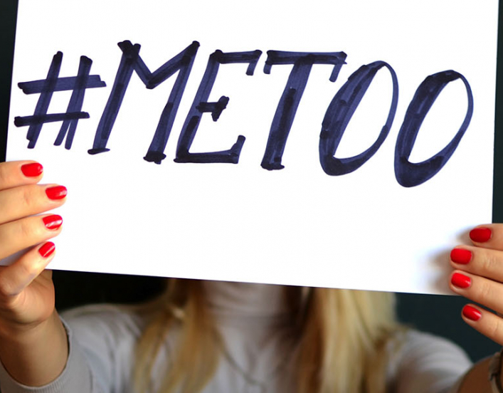Hands holding #MeToo sign