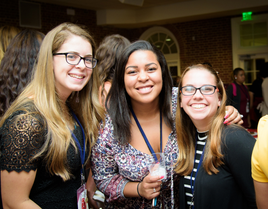 Three young women at the National Conference for College Women Student Leaders
