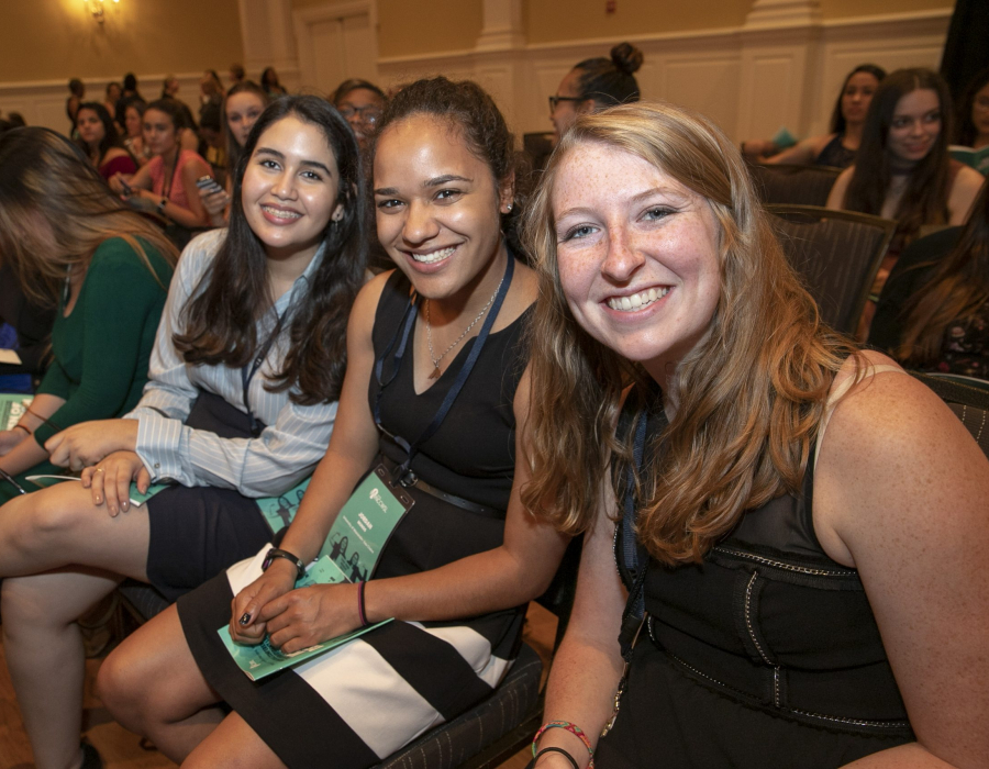Three young women attending the 2018 National Conference for College Women Student Leaders
