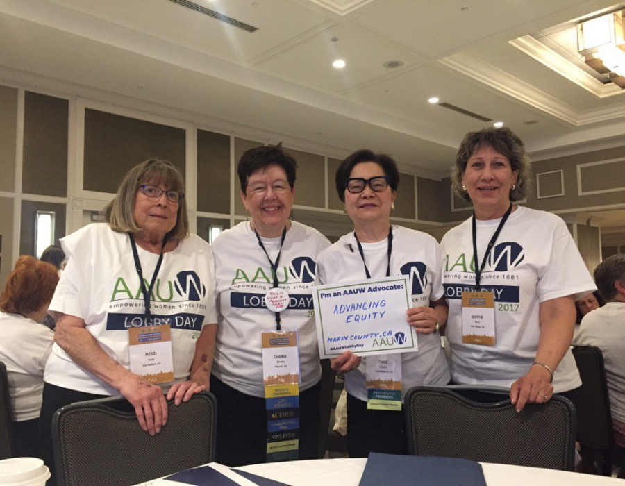 Four AAUW members with Lobby Day signs, including board member Cherie Sorokin