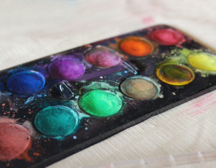 palette of paint (photo by Jen Theodore for Unsplash)