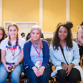 Four students at the National Conference for College Women Student Leaders