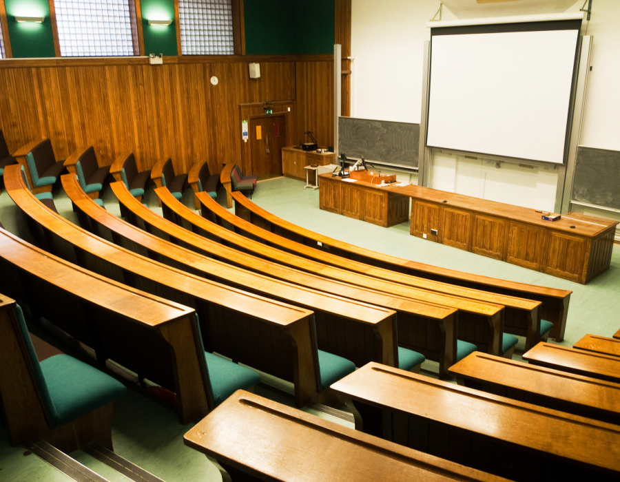 Photo of empty university lecture hall.