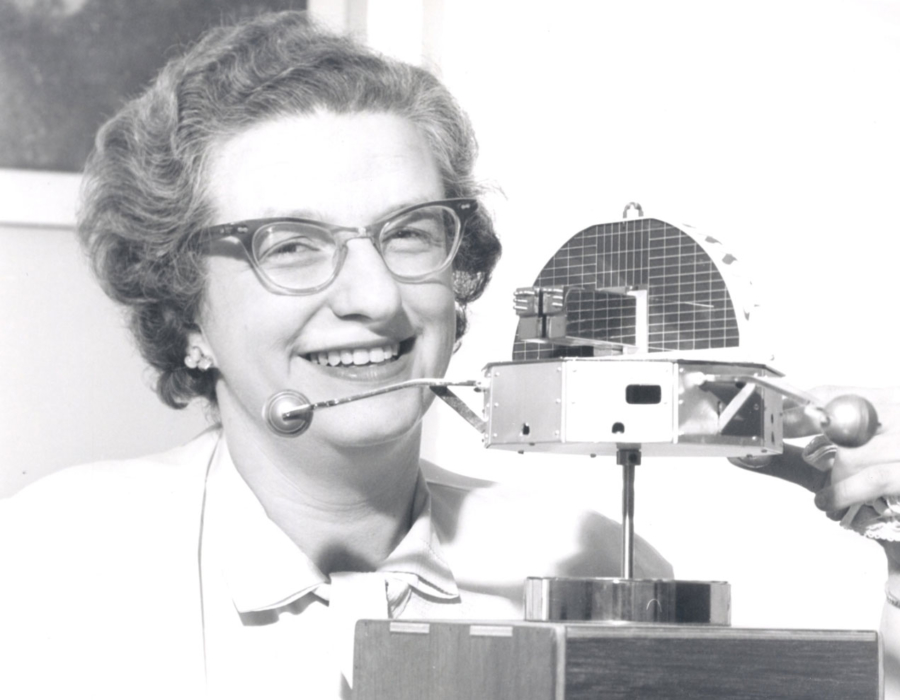 Nancy Grace Roman with a model of the Orbiting Solar Observatory in 1962.
