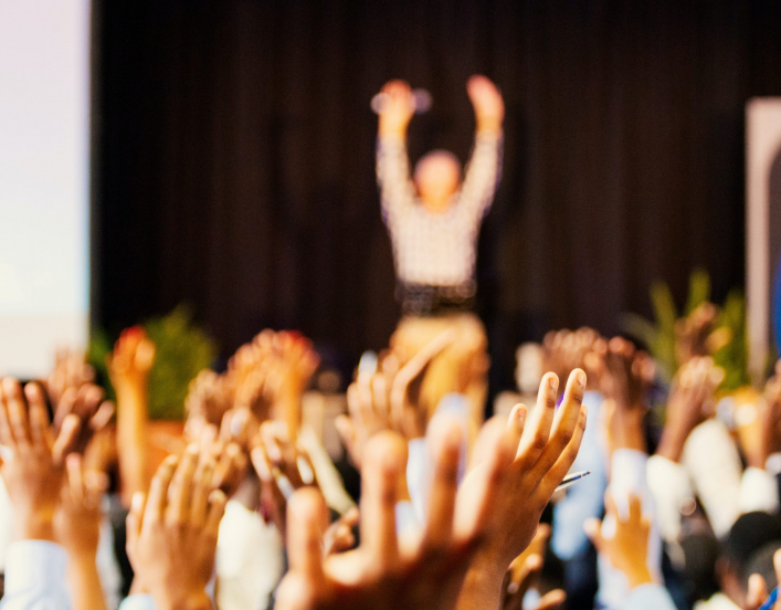 hands raising at a conference