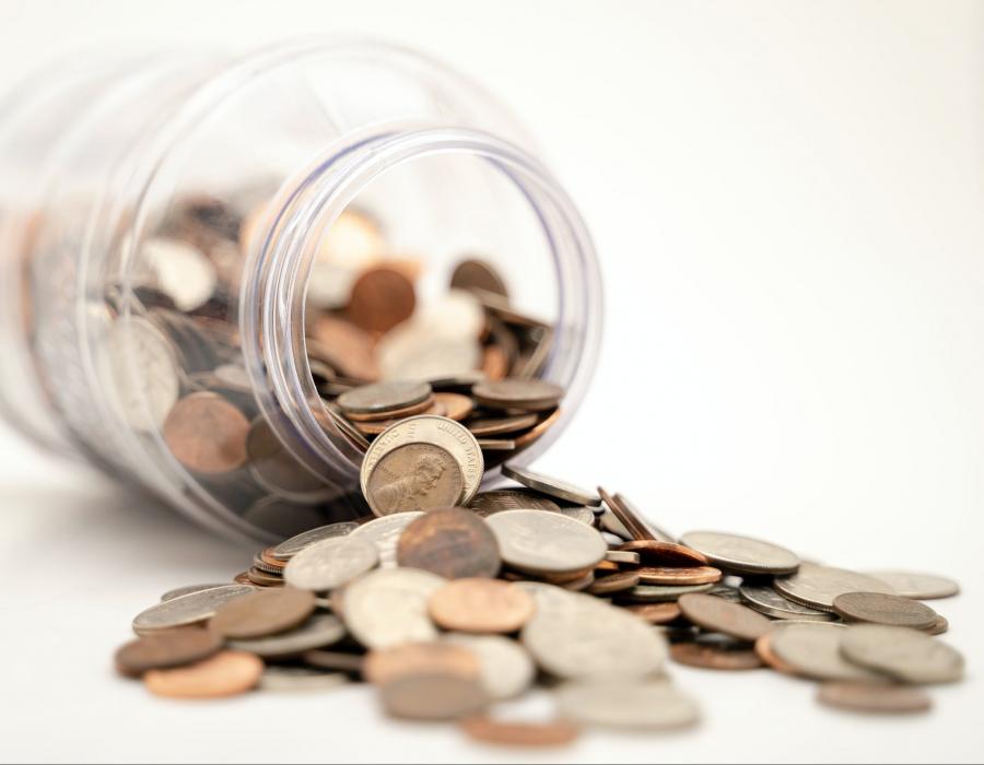 A jar of coins spilled over