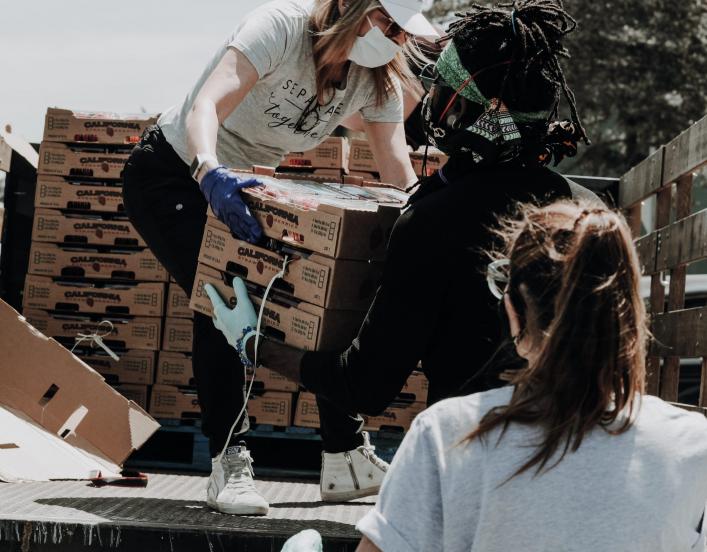 Two women doing volunteer work